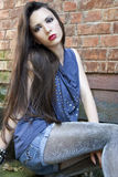 Fashion girl. Beautiful girl with long hair in sparkly tights Royalty Free Stock Photography