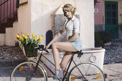 Fashion girl on bicycle Stock Image