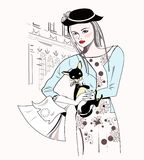 Fashion girl in black hat with a little dog Royalty Free Stock Photography