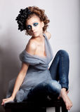 Fashion girl with black wreath sitting royalty free stock photos