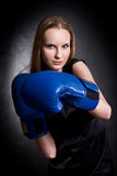 Fashion girl in boxing gloves. Fashion girl in blue boxing gloves royalty free stock photos