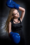 Fashion girl in boxing gloves Royalty Free Stock Photography