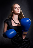 Fashion girl in boxing gloves. Fashion girl in blue boxing gloves stock photo