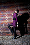 Fashion girl and brick wall Stock Image