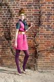 Fashion girl brick wall ivy Royalty Free Stock Image