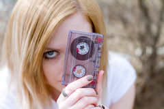 Fashion girl with a cassette in hand Stock Photography