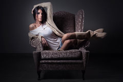 Fashion girl in chair Stock Photos