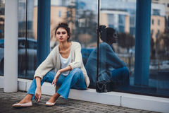 Fashion girl in clothes from 90`s Royalty Free Stock Photo