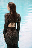 Fashion girl clothes in water Stock Photography