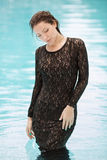 Fashion girl clothes in water Royalty Free Stock Photo