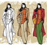Fashion girl in coat. Sketch style. Grunge Royalty Free Stock Photography