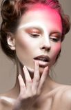 Fashion girl with creative make-up art and unusual hairstyle. Beauty face. Royalty Free Stock Images