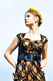 Fashion girl with crown from dandelions Stock Images