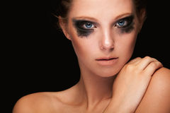 Fashion girl crying make up on black Stock Photos