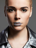 Fashion girl with crystals on lips wearing silver jacket Stock Photography