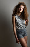 Fashion girl with curly hair Stock Photography