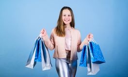 Fashion girl customer. Happy child in shop with bags. Shopping day happiness. Buy clothes. Birthday girl shopping. Fashion boutique. Fashion trend. Fashion stock photography