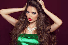 Fashion girl with diamonds. Beautiful elegant woman with long ha Royalty Free Stock Images
