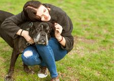 Fashion girl with a dog make selfie on the green grass. Cane Co. Rso royalty free stock photo