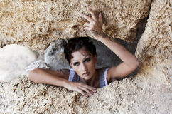 The girl in the cave Royalty Free Stock Image