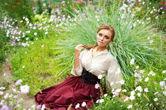 Fashion girl enjoying a summer day in garden Royalty Free Stock Photography