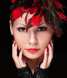 Fashion girl with feathers. Young woman with red lipstick Royalty Free Stock Photo