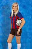Fashion girl with a football Royalty Free Stock Photography