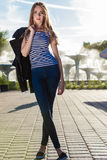 Fashion girl in full length against city fountain Stock Images