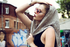 Fashion girl. In glasses, dress, scarf and makeup Royalty Free Stock Photography