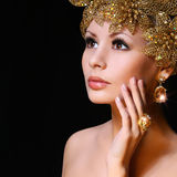 Fashion Girl with Gold Jewelries. Beauty young woman Royalty Free Stock Image