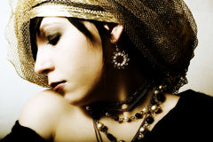 Fashion girl in golden boa. And beads Royalty Free Stock Photos