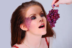 Fashion girl with grapes Royalty Free Stock Image