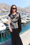 Fashion Girl at Greece Island. Beautiful tourist in Greece - Houses at Hydra island - Greece Stock Photography