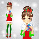 Fashion Girl In Green Santa Socks Holding Gift Stock Images