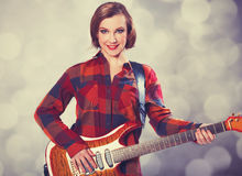 Fashion girl with guitar Royalty Free Stock Image
