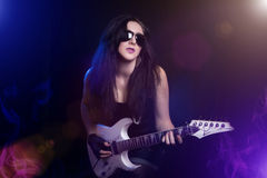 Fashion girl with guitar playing hard rock Stock Images