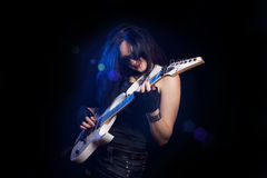 Fashion girl with guitar playing hard rock Stock Photo