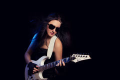 Fashion girl with guitar playing hard rock Royalty Free Stock Image