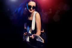 Fashion girl with guitar playing hard rock Royalty Free Stock Photography
