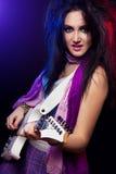 Fashion girl with guitar playing hard rock Stock Image