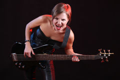 Fashion girl with guitar playing rock Stock Image
