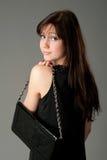 Fashion girl with handbag Royalty Free Stock Images