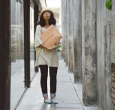 Fashion girl with handbag at alleyway Royalty Free Stock Images