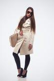 Fashion girl with handbag Royalty Free Stock Photography