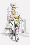 Fashion Girl in the hat on the bicycle in Paris. The Eiffel tower and restaurant entrance royalty free illustration