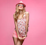Fashion girl Having Fun Crazy Dance. Pink Hat Stock Image