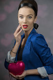 Fashion girl with heart shape bag Royalty Free Stock Photography