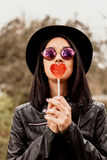 Fashion girl hipster with red lollipop Stock Photography