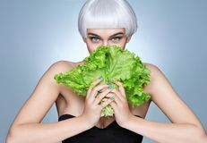 Fashion girl holding a lettuce leaves. stock image