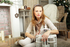 Fashion girl at home, winter interior. Fashion girl at home, vintage winter interior Royalty Free Stock Photo